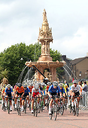 The peloton passes the Doulton Fountain in Glasgow Green on the 8th lap of the Women's 130km Road Race during day four of the 2018 European Championships at the Glasgow Cycling Road Race Course.