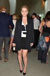 ALICE EVE at a summer drinks party hosted by Bec Astley Clarke at the Serpentine Sackler Gallery, Hyde Park, London on 17th June 2014.