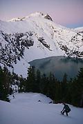 Snowshoers approach the final ridge ascent to the summit of Snowking Mountain, Glacier Peak Wilderness, Washington.