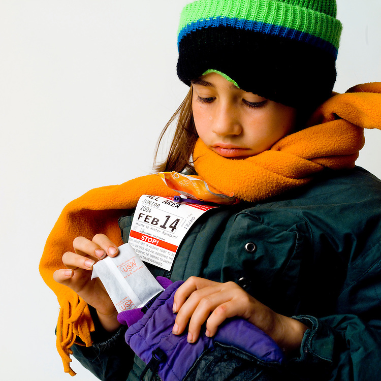 Chemical energy in a hand warmer. Girl going skiing.
