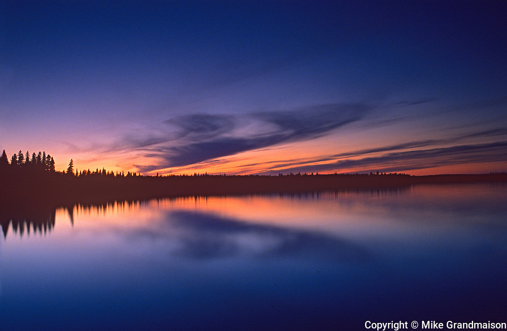 Reflection on Winnipeg River at dawn, Whiteshell Provincial Park, Manitoba, Canada