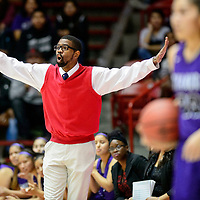 Miyamura Patriot  varsity girls basketball coach Steven Gilbert calls out to his team as they face off with the Gallup Bengals during a District 5A quarterfinal at The Pit in Albuquerque Tuesday.