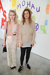 Left to right, FLYNN RODDAM and INDIGO LEWIN at a charity lunch organised in aid of ASAP (African Solutions to African Problems) held at the Louise T Blouin Foundation, 3 Olaf Street, London W11 on 23rd June 2010.