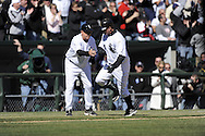 CHICAGO - APRIL 07:  Jim Thome #25 of the Chicago White Sox is greeted by third base coach Jeff Cox #6 after hitting a three run home run in the eighth inning against Kyle Farnsworth #40 of the Kansas City Royals on April 7, 2009 at U.S. Cellular Field in Chicago, Illinois.  The White Sox defeated the Royals 4-2.  (Photo by Ron Vesely)
