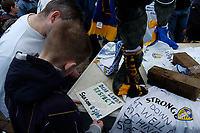 Photo. Glyn Thomas.<br /> Digitalsport<br /> NORWAY ONLY<br /> <br /> Leeds United v Charlton Athletic. <br /> FA Barclaycard Premiership. 08/05/2004.<br /> Leeds fans read messages of support for their side as they face relegation to Division 1.
