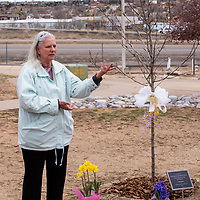 Joyce Graves talks about her husband, Paul Graves' passion for recycling at the tree dedication for him and Octavia Fellin at We the People Park Saturday during the Earth Day Celebration in Gallup.