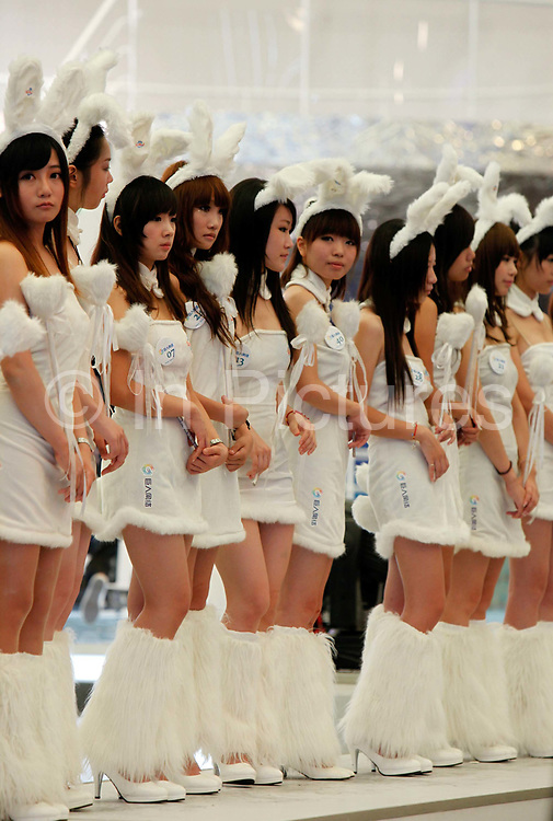 Models employed by one of the gaming companies and wearing bunny suites line up on stage at the ChinaJoy Expo, the annual online gaming expo, in Shanghai, China on 30 July, 2011.   China is now the world's largest online gaming market, contributing one-third to the global revenue in this sector in 2009, or 56 percent of the Asia Pacific total. Online and social network games have become hugely popular in China as Chinese children lack the space and facility require for sports, spurning worries from parents and government officials on internet addiction.