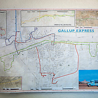 A map of Gallup Express bus routes hang on the wall at the Gallup Express office on Warehouse Lane in Gallup.
