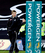Watford, Herts, UK., 19th December 2004, Power Gen Cup, Saracens vs Newcastle Falcons, 19.12.2004, Watford, ENGLAND:<br /> Newcastle coach Rob Andrew watches his squad 'warm up' before their opening game in defence of the Powergen Cup. <br /> Watford, Hertfordshire, England, UK., 19th December 2004, [Mandatory Credit: Peter Spurrier],