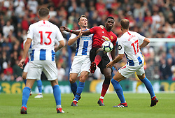 Manchester United's Paul Pogba (centre) battles for the ball with Brighton & Hove Albion's Dale Stephens (left) and Glenn Murray (right) during the Premier League match at the AMEX Stadium, Brighton.