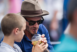 David Beckham and Romeo Beckham watching during the mens singles second round match between Jordan Thompson of Australia and Sam Querry of The United States on day four of the 2017 Aegon Championships at Queens Club. 24 Jun 2017 Pictured: David Beckham, Romeo Beckham. Photo credit: TBA / MEGA TheMegaAgency.com +1 888 505 6342