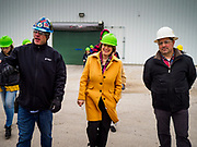 12 APRIL 2019 - NEVADA, IOWA: CHRIS CLEVELAND, Production Manager of Lincolnway Energy, (left), US Senator AMY KLOBUCHAR, (D-MN) and MIKE HOLLENBERG, CEO of Lincolnway Energy, (right), during a tour of the Lincolnway Energy ethanol plant in Nevada, IA. Winds in the area gusted over 40MPH Friday. Sen. Klobuchar is touring Iowa this weekend to support her bid for the Democratic nomination of for the US Presidency. Iowa traditionally hosts the the first election event of the presidential election cycle. The Iowa Caucuses will be on Feb. 3, 2020.     PHOTO BY JACK KURTZ