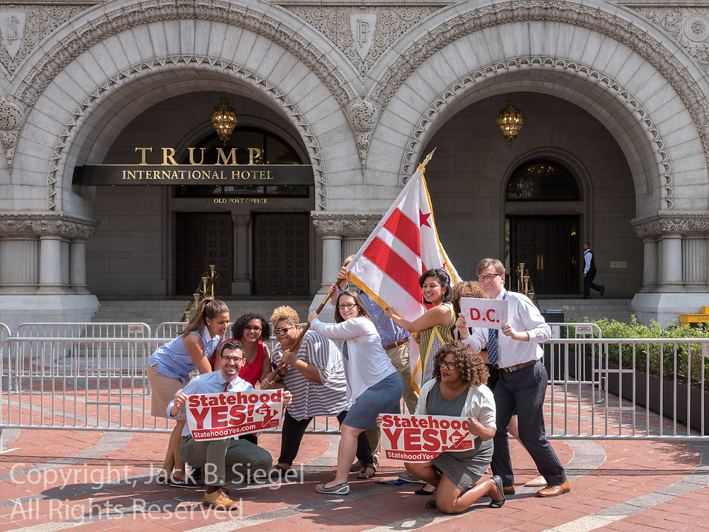 Several demonstrators who want the District of Columbia to become a state demonstrating outside the Trump International Hotel in Washington, D.C.