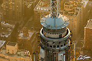 Aerial closeup view of the spire of the Empire State Building at sunrise, photographed from a helicopter.