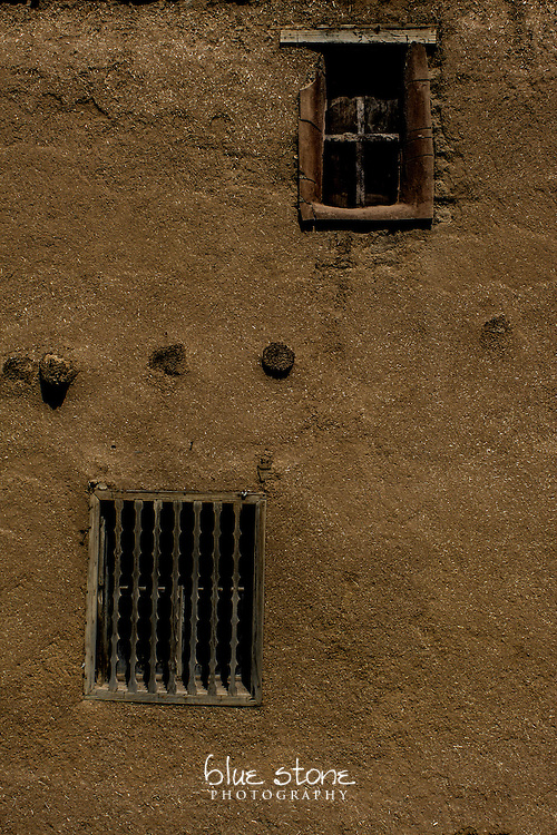 Historic adobe structure that shows the detail of the adobe and windows.