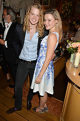 FREDRIK FERRIER and AMBER ATHERTON at a party to celebrate 35 years of Harry's Bar, 26 South Audley Street, London on 19th September 2014.