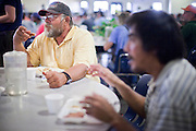 """Sept. 27 - PHOENIX, AZ: DeLANO, a client at the Society of St. Vincent de Paul in Phoenix, eats his lunch, Monday, Sept 27. He's coming to lunch service at St. Vincent de Paul for about a month. September 27, 2010 is the 350th Feast Day of Saint Vincent de Paul, also known as the """"Apostle of Charity."""" To mark the day, the Society of St. Vincent de Paul in Phoenix served birthday cake during the lunch service. The US Census office recently announced that poverty in the US has spiked to 14.3% of the population, the highest poverty rate since 1994. Officials at St. Vincent de Paul in Phoenix said that demand for their services have increased steadily in the last three years. They currently feed about 1,100 people, either homeless or members of the working poor, every day.    Photo by Jack Kurtz"""