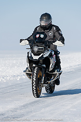 On the mile long track at the Kilill Dymichkin on his BMW R1250 at the Baikal Mile Ice Speed Festival. Maksimiha, Siberia, Russia. Friday, February 28, 2020. Photography ©2020 Michael Lichter.