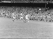 Roscommon palms the ball forward as he was chased by Armagh during the All Ireland Senior Gaelic Football Semi Final Replay Roscommon v Armagh in Croke Park on the 28th August 1977. Armagh 0-15 Roscommon 0-14.