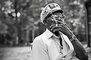 Blues singer Captain Luke smokes a cigarette while enjoying the warm North Carolina weather.