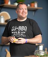 NATHAN OUTLAW cooking fish burgers at the Big Feastival 2021 on Alex James Cotswolds farm, Kingham oxfordshire photo by Michael Butterworth