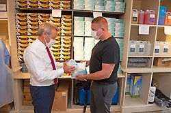 ©Licensed to London News Pictures 15/07/2020     <br /> Chislehurst, UK. Raymond Smith (r) helping customer Paul Britt. Business man and director Raymond Smith has opened a PPE shop on Chislehurst High Street in Chislehurst, South East London. Bringing wholesale prices to the public with no online waiting time its believed to be the first high street shop of its kind in the UK helping in the fight against coronavirus. Photo credit: Grant Falvey/LNP