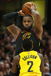 April 29, 2018 - Cleveland, OH, USA - Cleveland Cavaliers forward LeBron James keeps the ball from Indiana Pacers guard Darren Collison in the third quarter of Game 7 of the Eastern Conference First Round series on Sunday, April 29, 2018 at Quicken Loans Arena in Cleveland, Ohio. The Cavs won the game, 105-101. (Credit Image: © Leah Klafczynski/TNS via ZUMA Wire)