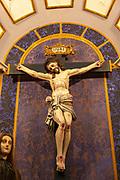 Ornately decorated Jesus Christ crucified  on Cross church Igreja de Santiago, Tavira, Algarve, Portugal, Southern Europe