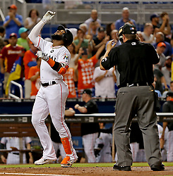 May 30, 2017 - Miami, FL, USA - The Miami Marlins' Marcell Ozuna celebrates his second-inning home run as he crosses the plate against the Philadelphia Phillies at Marlins Park in Miami on Tuesday, May 30, 2017. The Marlins won, 7-2. (Credit Image: © Patrick Farrell/TNS via ZUMA Wire)