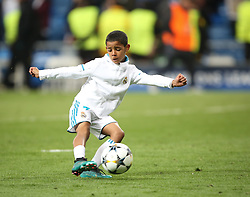 May 1, 2018 - Madrid, Spain - Cristiano Ronaldo Jr, son of Cristiano Ronaldo of Real Madrid plays with a ball prior the UEFA Champions League, semi final, 2nd leg football match between Real Madrid and Bayern Munich on May 1, 2018 at Santiago Bernabeu stadium in Madrid, Spain  (Credit Image: © Raddad Jebarah/NurPhoto via ZUMA Press)