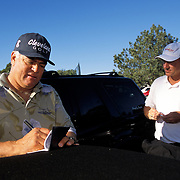 Former US Open winner Scott Simpson pays Cliff Robinson after using him for the first two rounds of the Buick Invitational in San Diego. Robinson got lucky and was picked-up in the parking lot to work for Simpson that week. Simpson failed to make the cut so Robinson received the standard rate of between $800-$1000 instead of 5-10% of Simpson's torunament winnings.