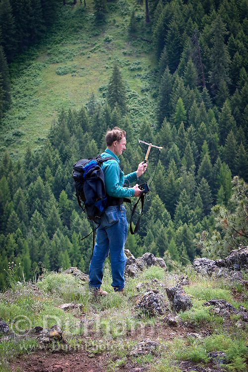 Oregon Division Of Fish and Wildlife biologist Scott Findholdt searches for Elk using a radio telemetry. Blue Mountains, Oregon. Sled Springs Study Area.