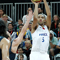 31 July 2012: France Nicolas Batum takes a jumpshot during 71-64 Team France victory over Team Argentina, during the men's basketball preliminary, at the Basketball Arena, in London, Great Britain.