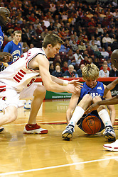 Kyle Korver tries to get control of the ball as Andy Strandmark zips in.