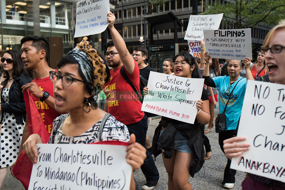 August 15, 2017 - Chicago, Illinois, United States - Demonstrators march towards Trump International Hotel and Tower Chicago in solidarity with the victims of the recent racist violence in Charlottesville, Va., in Chicago on August 15, 2017. People across the country continue to mourn the loss of demonstrator Heather Heyer and those injured when a car ran into a protest against white nationalists in Charlottesville, Va and are critical of President Donald Trump's vague response to the incident. (Credit Image: © Max Herman/NurPhoto via ZUMA Press)
