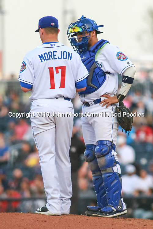 Amarillo Sod Poodles pitcher Adrian Morejon (17) and catcher Webster Rivas (8) talk on the mound against the Midland RockHounds on Wednesday, April 10, 2019, at HODGETOWN in Amarillo, Texas. [Photo by John Moore/Amarillo Sod Poodles]