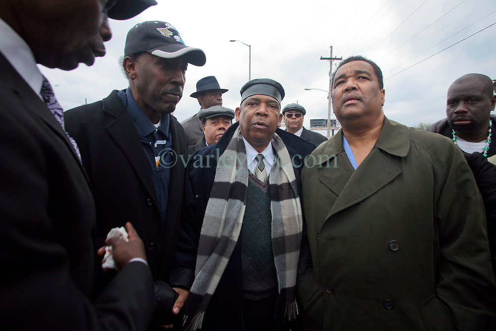02 March 2010. New Orleans, Louisiana, USA. <br /> Civil Rights leaders gather at the notorious Danziger Bridge in New Orleans East, scene of the Sunday Sept 4th, 2005 murder of 40 yr old Ronald Madison and 19 yr old James Brissette by New Orleans police. <br /> Reverend Dr Norwood Thompson and Doctor Romell Madison (2nd rt), brother of victim Ronald Madison following  their address to the media.<br /> The police are under federal investigation for an alleged cover up of the botched killings in the chaotic aftermath of hurricane Katrina. <br /> Photo; Charlie Varley.