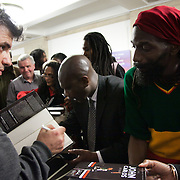 """Writer Dave Zirin sign his book """" The John Carlos Story'Resistance: The best Olympic Spirit. With John Carlos, Doreen Lawrence, Janet Alder and others."""