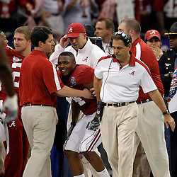 Jan 9, 2012; New Orleans, LA, USA; Alabama Crimson Tide wide receiver Marquis Maze (4) reacts on the sideline behind head coach Nick Saban after an injury following a punt return during the first half against the LSU Tigers in the 2012 BCS National Championship game at the Mercedes-Benz Superdome.  Mandatory Credit: Derick E. Hingle-US PRESSWIRE