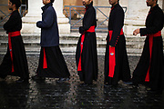 Priests line up for the pre-conclave mass in St. Peter's Square during the first day of conclave and the selection of the new Pope in Vatican City, March 12, 2013. Photograph by Todd Korol