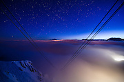 Get your ski trip off to a flying start! Cable car 9,000ft up in the French Alps turned into a luxury room for overnight stays<br /> <br /> A cable car suspended 8,858ft above the ground has been transformed into a luxury bedroom in one of the world's most popular ski resorts.<br /> Ski lovers are being offered the chance to spend the night in a Saulire cable car in Courchevel, France.<br /> The hotel room, which offers guests the perfect location to hit the slopes the next morning, is being offered by accommodation website Airbnb.<br /> <br /> Perhaps unsurprisingly, the company say that the cable car, which is being equipped with a bed and a living room, is there highest ever European listing.<br /> However, the room is available for just one night only and will be offered as part of a competition.<br /> Guests are being invited to submit an application to Airbnb explaining why they want to spend a night in the Saulire cable car. All entried must have been received before midnight on the 26th February.<br /> The winning entry will be able to take three guests to the cable car on 6th March, which will be completely transformed in just a matter of hours after a day of skiing.<br /> <br /> <br /> After climbing the ski runs by snowmobile, the four guests will be greeted with traditional mulled wine at the Saulire Summit.<br /> Suspended over the Combe de Saulire, highly prized by the best freeriders, the guests will be served a typical savoyard dinner of cheese fondue.<br /> They will then tuck in for the night at the very top of the Saulire, the highest point of Courchevel.<br /> In the morning, they will have the privilege of laying down the 'first tracks' over an untouched snow run.<br /> Adeline Roux, Director of Courchevel Tourism, said: 'We are happy to offer a unique experience of the mountain to four lucky winners who will discover Courchevel from an unprecedented angle!<br /> 'We thrive on challenge and take pride in opening up new possibilities.'<br /> <br 