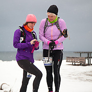 Marathon runners get sign up and get ready for their run. Salomon Hammer Trail Winter Edition is a first on Bornholm and is one of the toughest routes in Denmark. The 4 runs consist of a 50 mile run, a marathon, a 1/2 marathon and 10k all run a on an approximate 25km route which includes 860 meter vertical rise on the North East coast of the Danish island Bornholm. The cut-off time for the 50mile run was 16 hours and more than a hundred runners made it to the finishing line. The last runner across the line after 50 miles  was in after 15:14:40