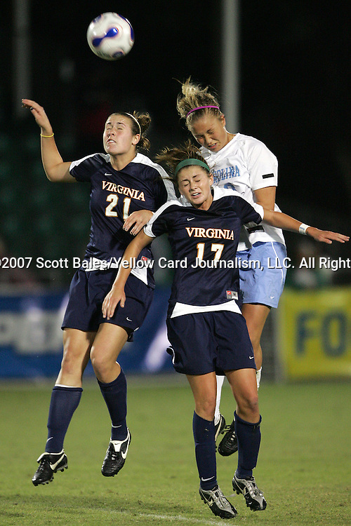 9 November 2007: Virginia's Meghan Lenczyk (21) and Sinead Farrelly (17) challenge North Carolina's Erin Mikula (right) for a header. The University of North Carolina tied the University of Virginia 1-1 at the Disney Wide World of Sports complex in Orlando, FL in an Atlantic Coast Conference tournament semifinal match.  UNC advanced to the finals on penalty kicks, 4-2.