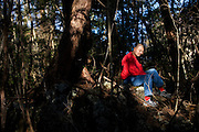 A man, 46, sits in contemplation at the site where exactly 2 years earlier on November 18, 2007 he tried to commit suicide in Aokigahara Jukai, better known as the Mt. Fuji suicide forest, in Yamanashi Prefecture west of Tokyo, Japan.
