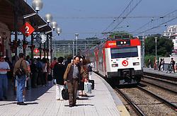 Passengers waiting on platform at Sitges railway station; Catalonia Catalunya,