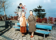 two senior Japanese women posing