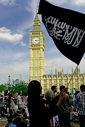 UK, LONDON 5th August 2006... Thousands of people joined a street protest agaist Israel war on Lebanon & Palestine, calling for an immediate ceasefire and to end Blair's support for Bush's wars.The organizers claim that aroung 100,000 protesters have marched from Hyde Park to Parliament Square. The initial Police figure is around 20,000. ..The Demo has been called by Stop the War Coalition, CND, Palestine Solidarity Campaign, British Muslim Initiative and Lebanese Community Organisations.