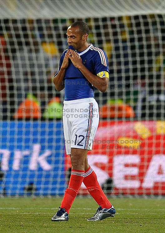 22-06-2010 VOETBAL: FIFA WORLDCUP 2010 FRANKRIJK - ZUID AFRIKA: JOHANNESBURG <br /> Thierry Henry of France dejected after France go out of the competition bottom of their group<br /> ©2010-FRH- NPH/ Marc Atkins (Netherlands only)