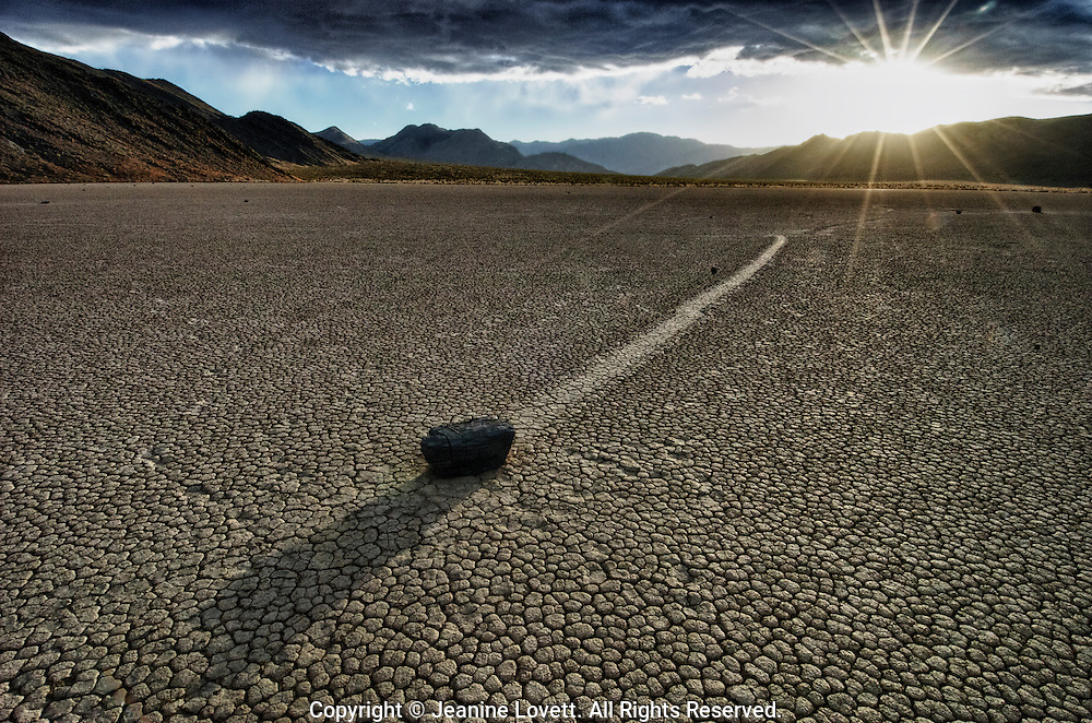 """The Racetrack, is a scenic dry lake feature with moving stones that leave linear """"racetrack"""" imprints. This photo was taken on a windy and very cold winter day."""