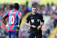 Referee Michael Oliver looks at Yannick Bolasie of Crystal Palace after cautioning the player. Barclays Premier League match, Crystal Palace v Norwich city at Selhurst Park in London on Saturday 9th April 2016. pic by John Patrick Fletcher, Andrew Orchard sports photography.